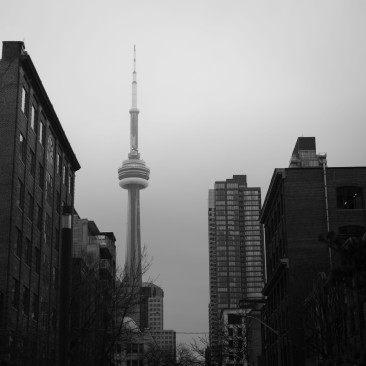 CN Tower framed by a street