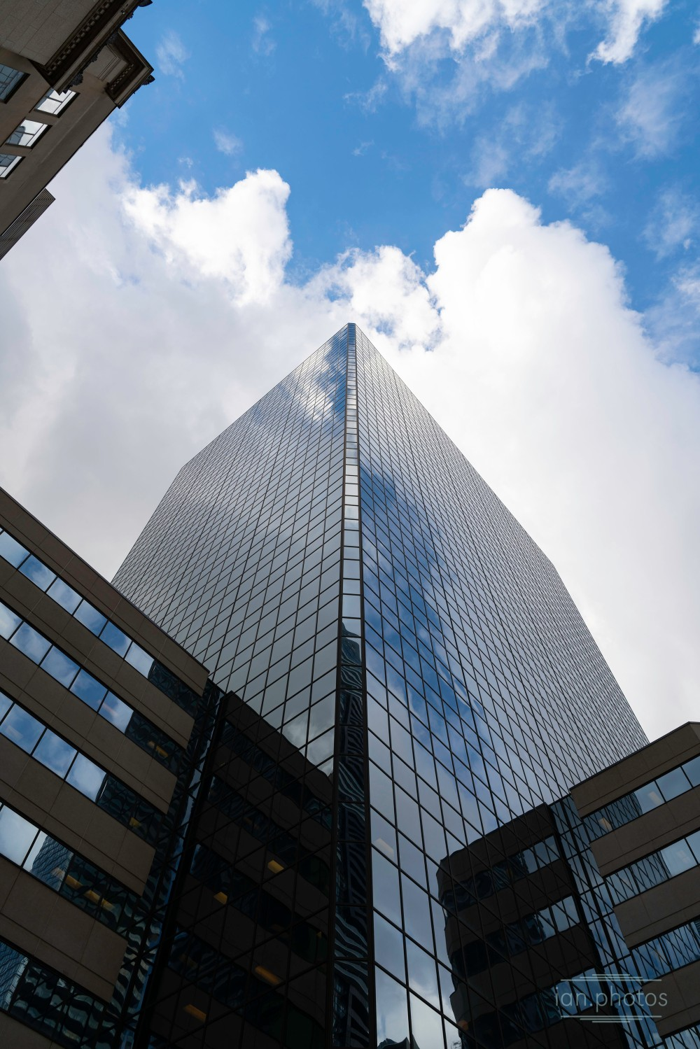 Towering Skyscrapper on a cloudy day. | ian.photos
