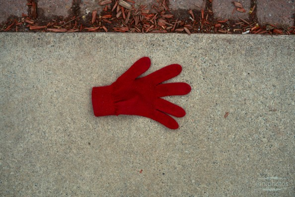 Lonely red glove on ground ian.photos