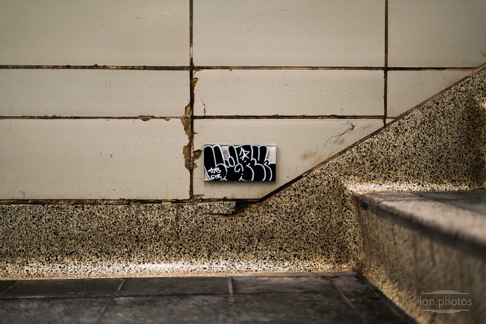 Tile tag inside a subway station | ian.photos