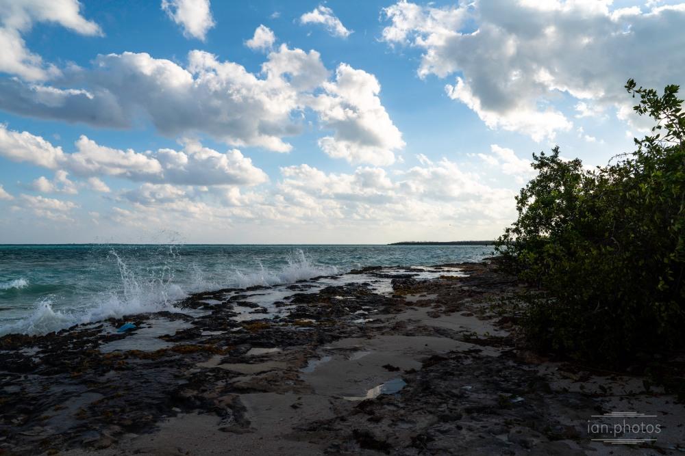 Sunny day with clouds on a rocky beach | ian.photos