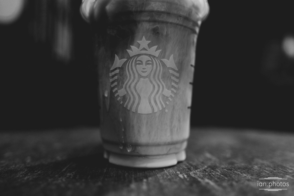 Black and white close up photo of a starbucks cup.